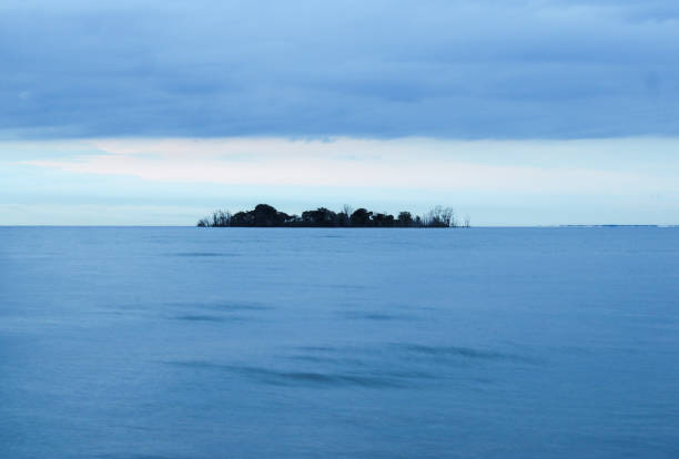 Mysterious Island morning blue stock photo