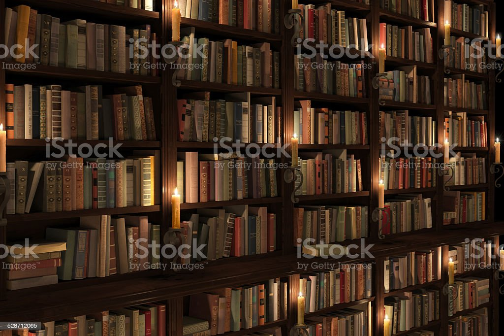 Mysterious library with candle lighting stock photo