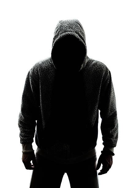 Mysterious man in silhouette stock photo