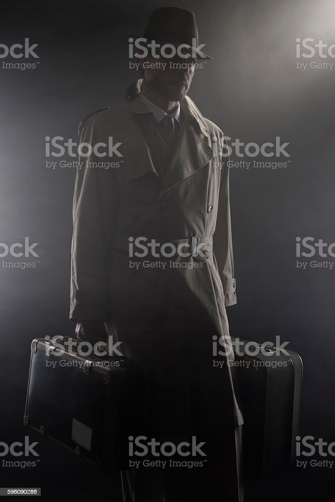 Mysterious man leaving late at night royalty-free stock photo