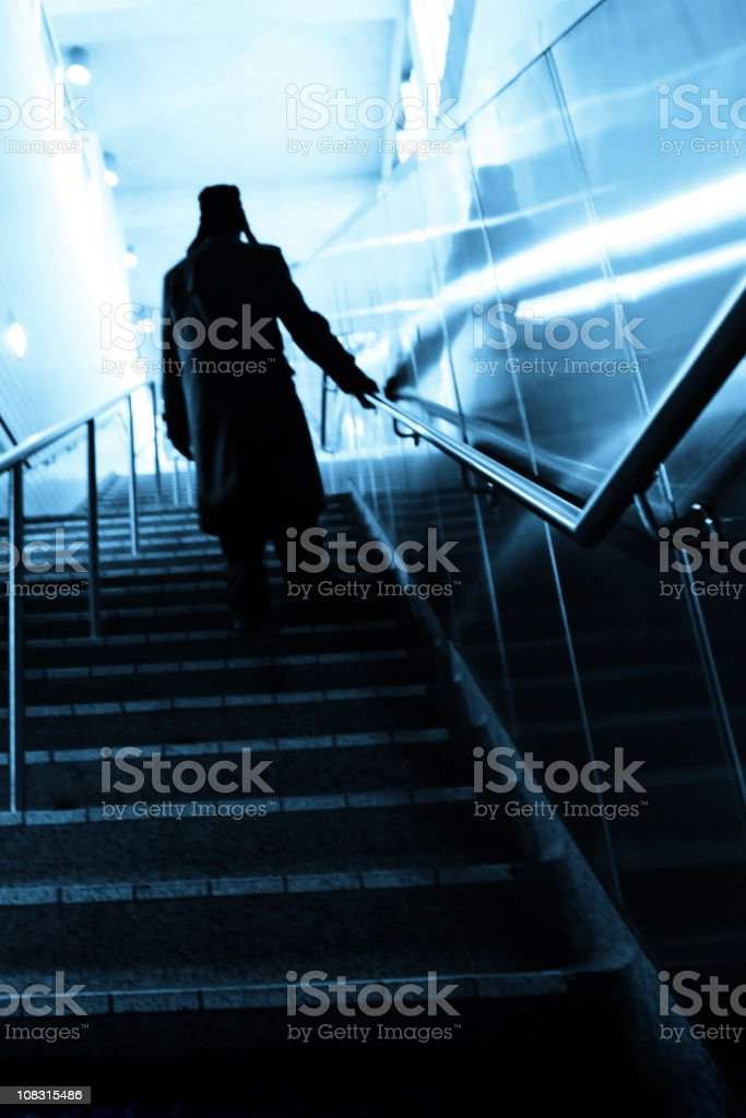mysterious man on stairs stock photo