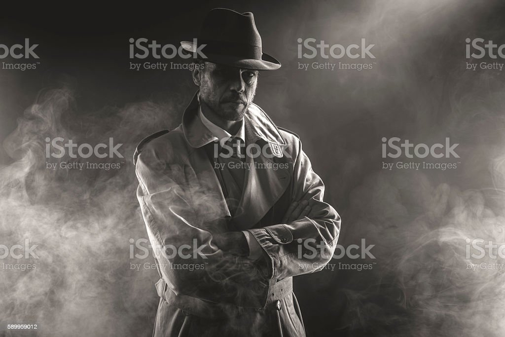 Mysterious man waiting in the fog stock photo