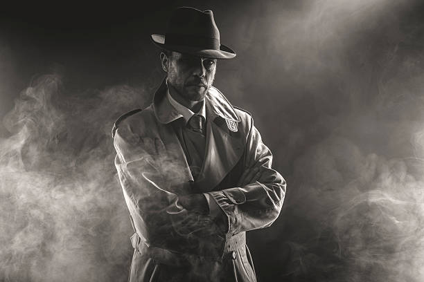 Mysterious man waiting in the fog Mysterious man waiting with arms crossed in the fog, 1950s style film noir detective stock pictures, royalty-free photos & images