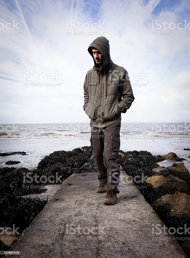 Mysterious man walking towards you stock photo