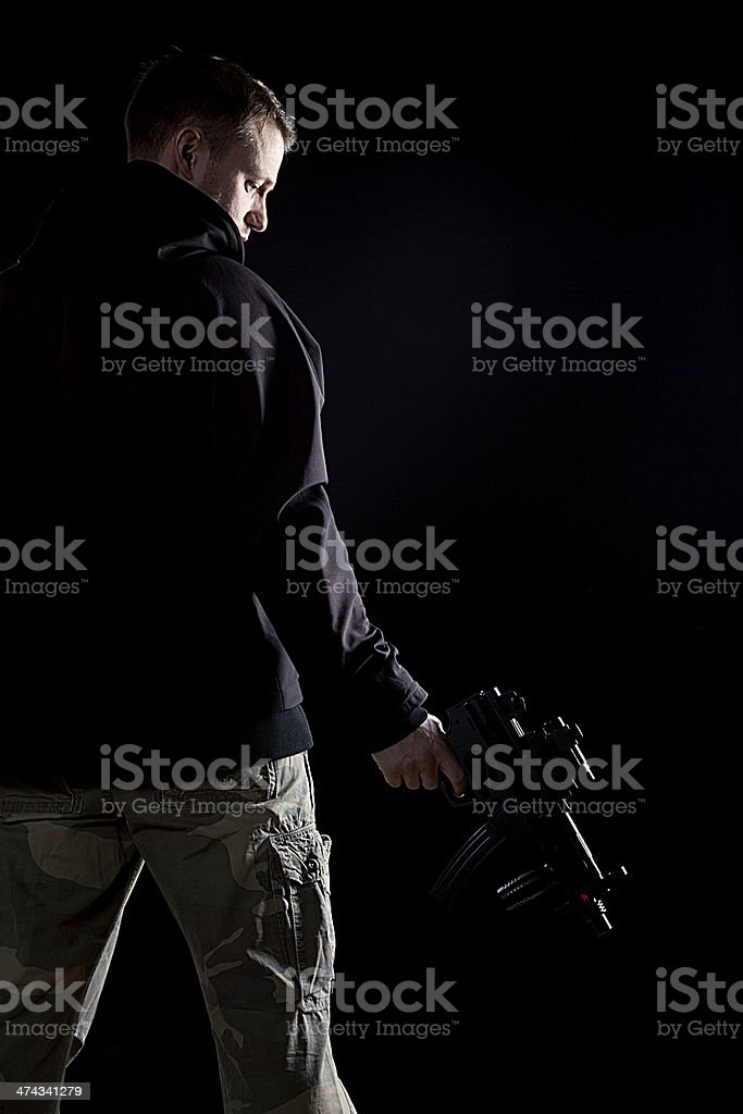 Mysterious man with gun stock photo