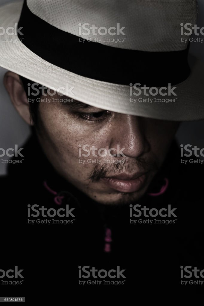 mysterious man with hat in the dark stock photo