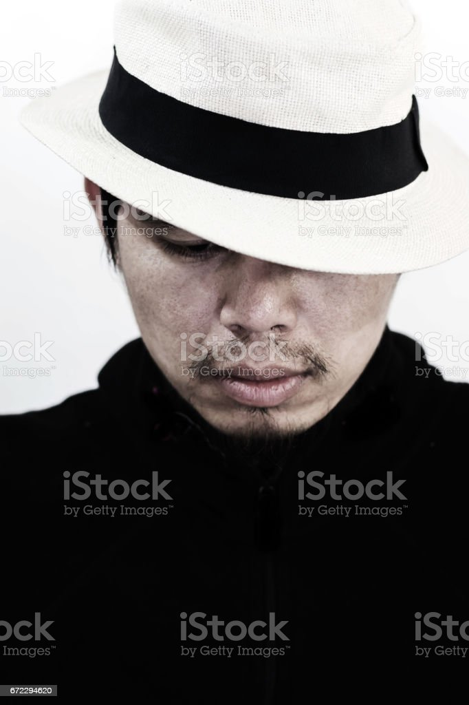 mysterious man with hat on white stock photo