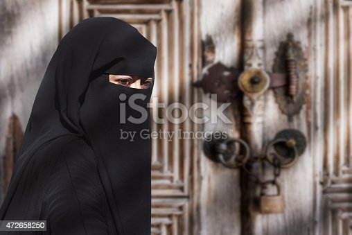 istock A mysterious Middle Eastern woman wearing a black Niqab 472658250