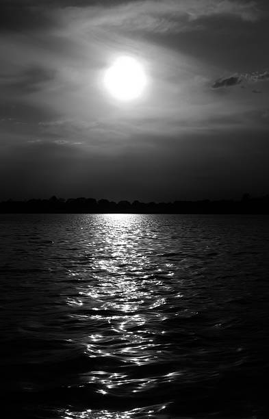 Mysterious moonlit waters stock photo