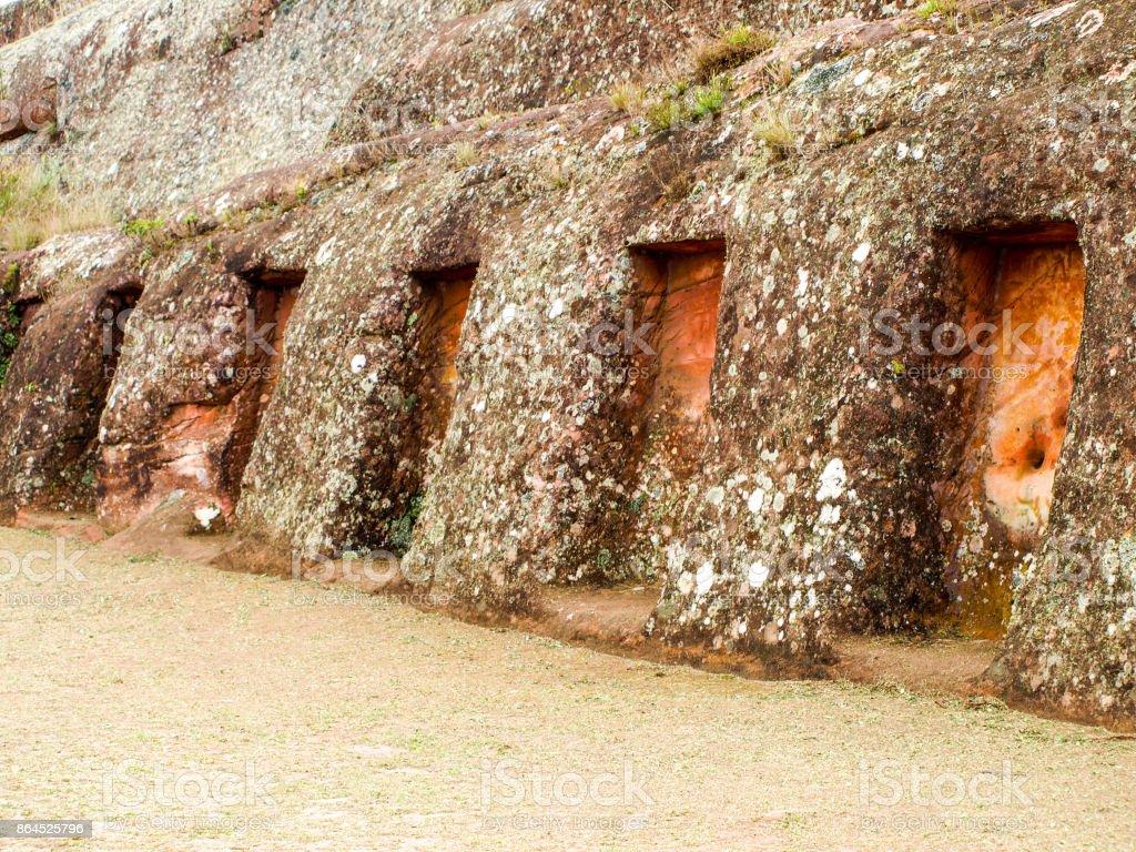 Mysterious niches in the rock, El Fuerte de Samaipata, Bolivia, South America. UNESCO World Heritage Site stock photo