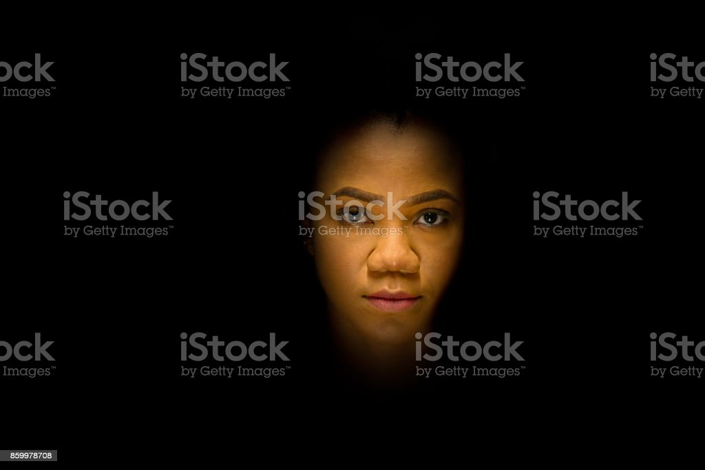 Mysterious night portrait of an African woman stock photo