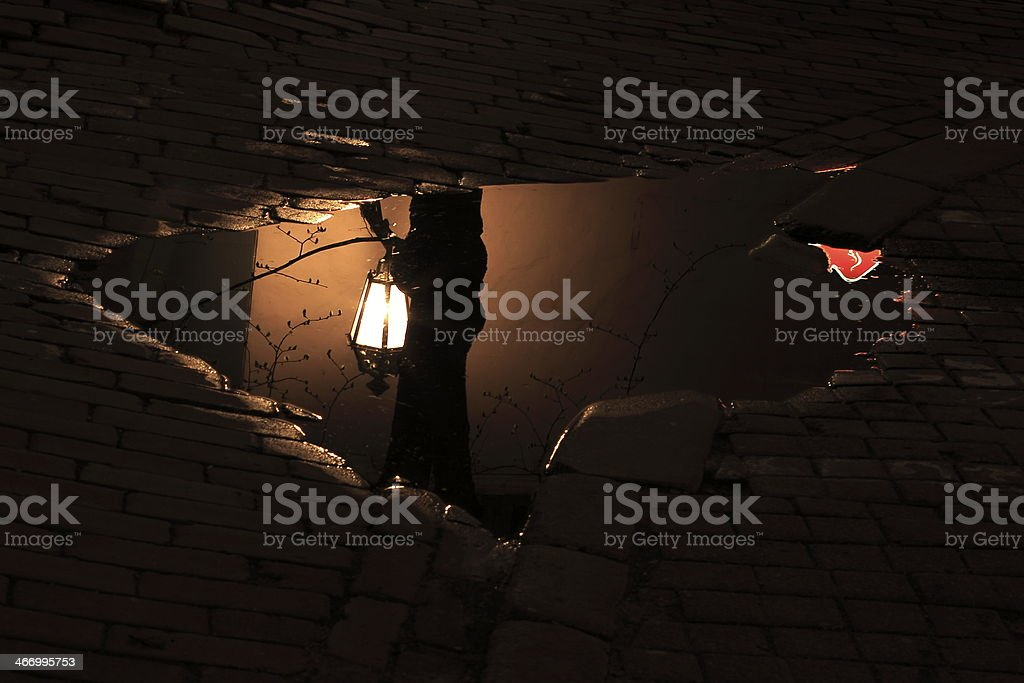 Mysterious puddle dark street ground in Vilnius, Lithuania, Baltics stock photo