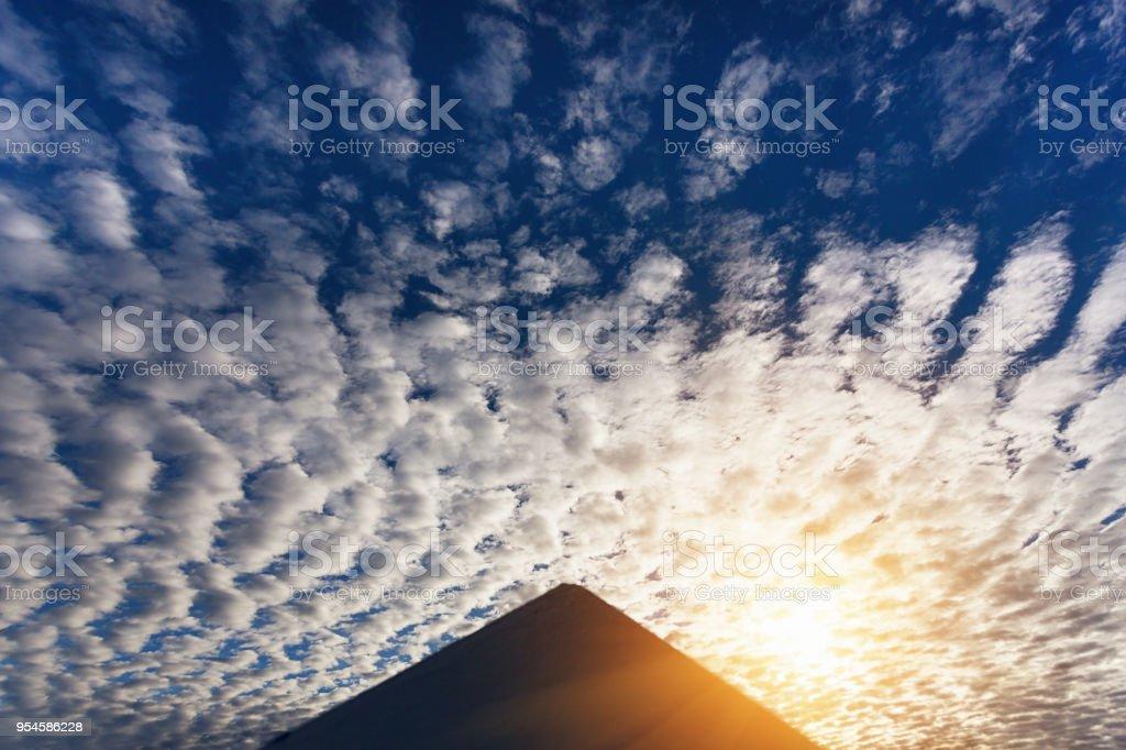 Mysterious pyramid against a dramatic dawn sky stock photo