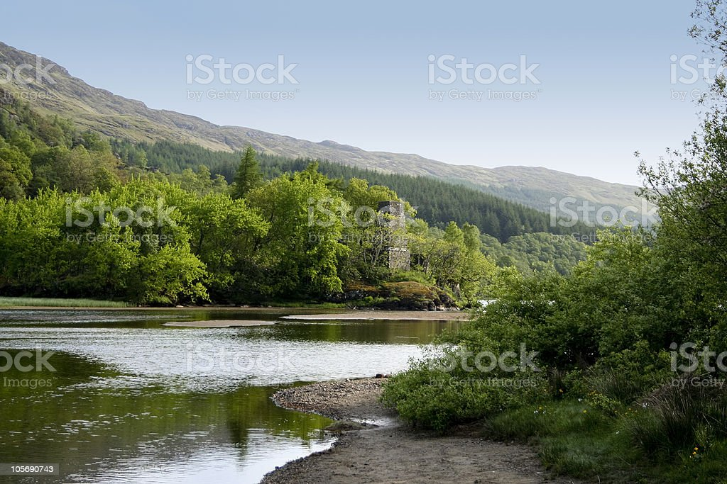 mysterious ruins beside scottish loch royalty-free stock photo