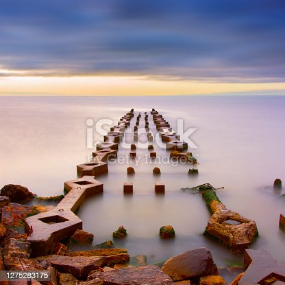 istock Mysterious ruins of pier structure built by ancient civilization. 1275283175
