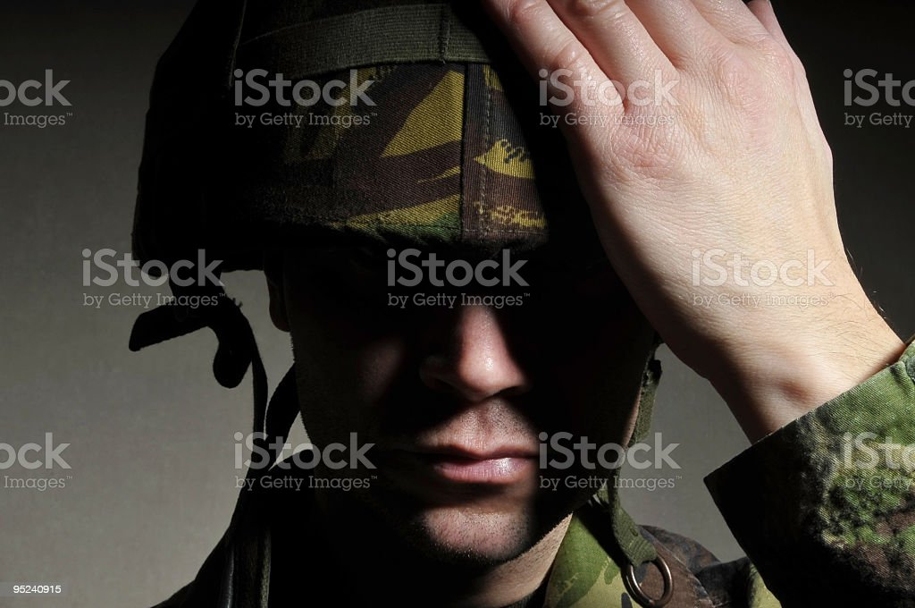 Mysterious Soldier in Shadow stock photo