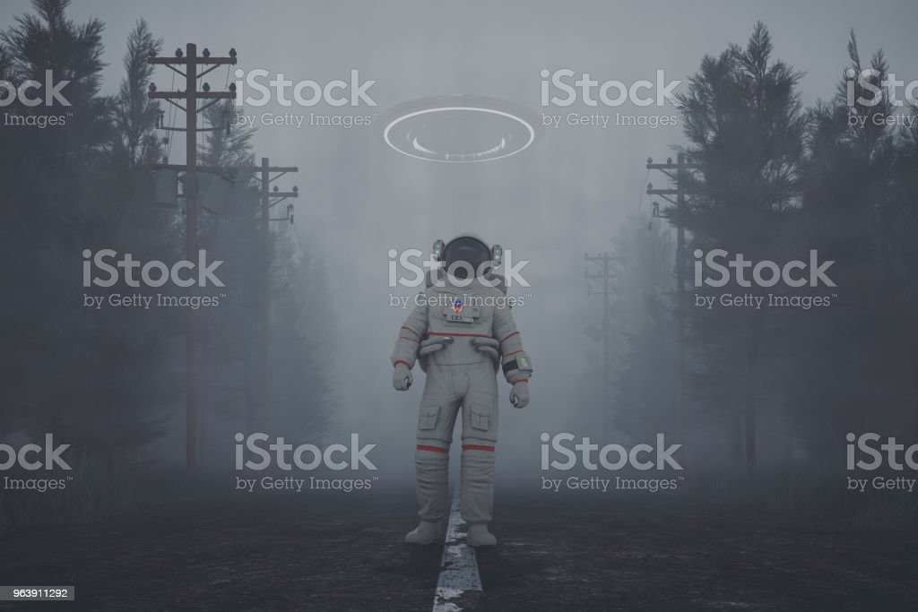 Mysterious UFO and walking astronaut on the forest road at night - Royalty-free Adult Stock Photo