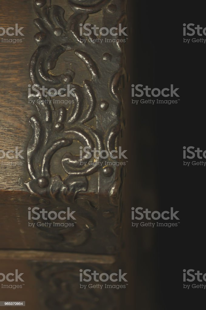 Mysterious view of the corner of an antique wooden chest from the 1700s royalty-free stock photo