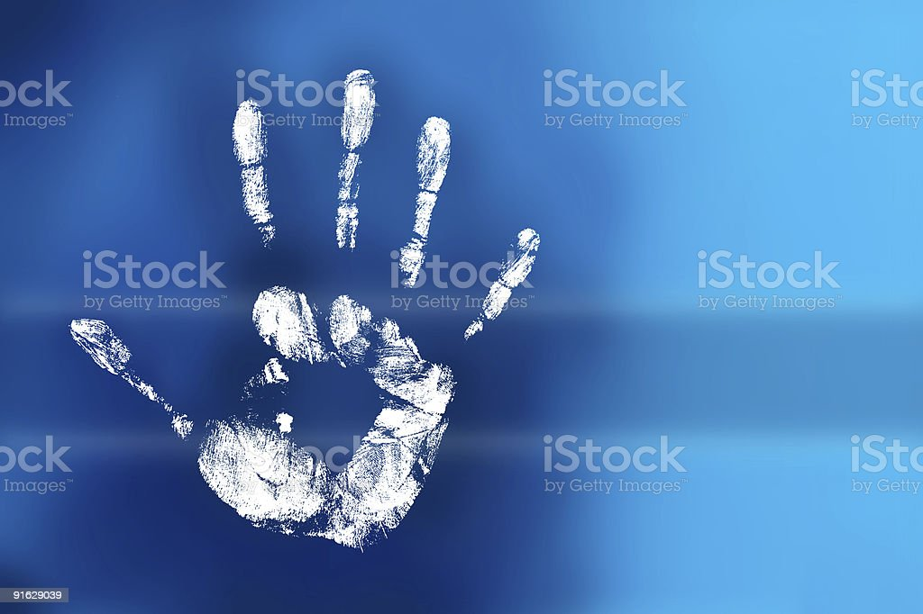 Mysterious white hand print placed on a blue surface royalty-free stock photo