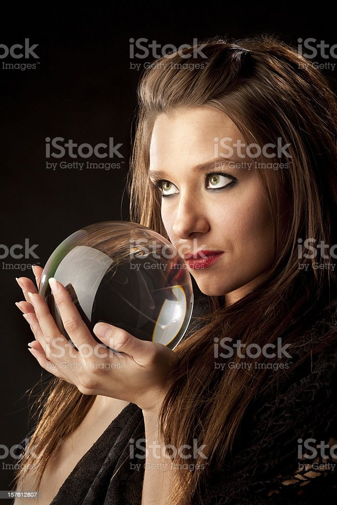 Mysterious Woman Fortune Teller With Crystal Ball stock photo