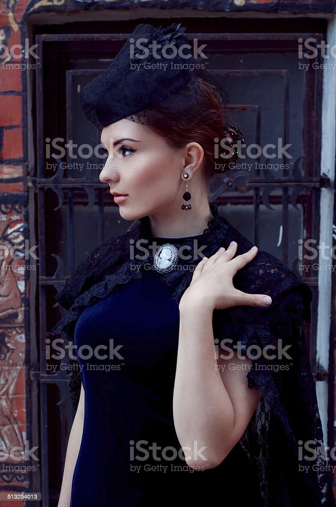 Mysterious woman in dark.Retro style. Victorian. stock photo