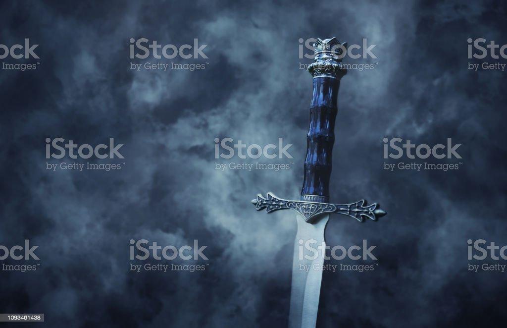 mysteriousand magical photo of silver sword over gothic snowy black background. Medieval period concept. - Zbiór zdjęć royalty-free (Antyczny)