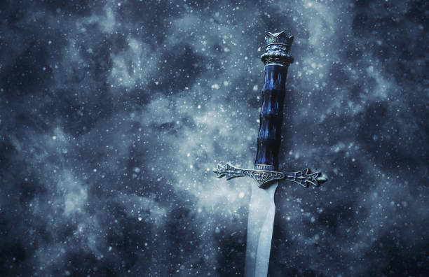 mysteriousand magical photo of silver sword over gothic snowy black background. medieval period concept. - periodo medievale foto e immagini stock