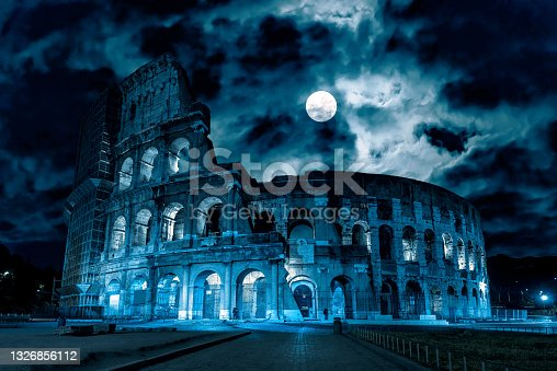 istock Mystery creepy view of Colosseum (Coliseum) at night, Rome, Italy 1326856112