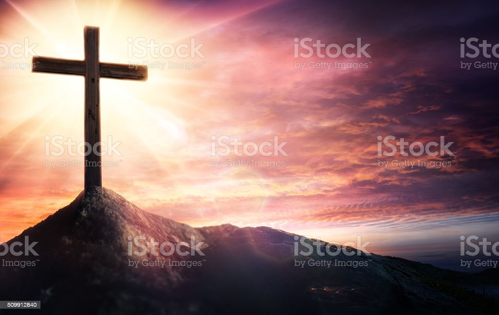Cross At Sunset On Hill With Rays