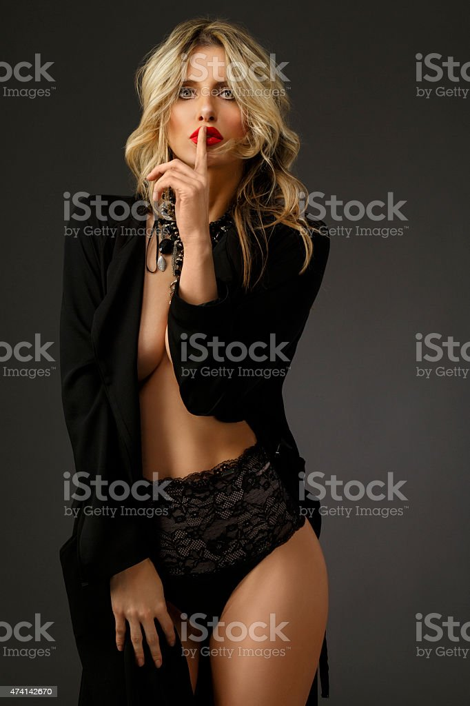 Mystery  Young Women  Wearing black sexy lingerie Finger on lips stock photo