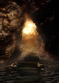 A fictional image underground in a cave with a path, candles and fire .