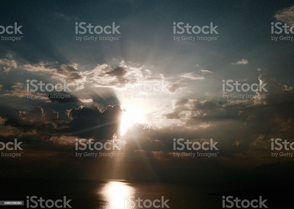Mystic clouds sunset in wild Albania beach royalty-free stock photo