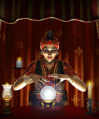 Mystic female Gypsy fortune teller with a lighted crystal ball