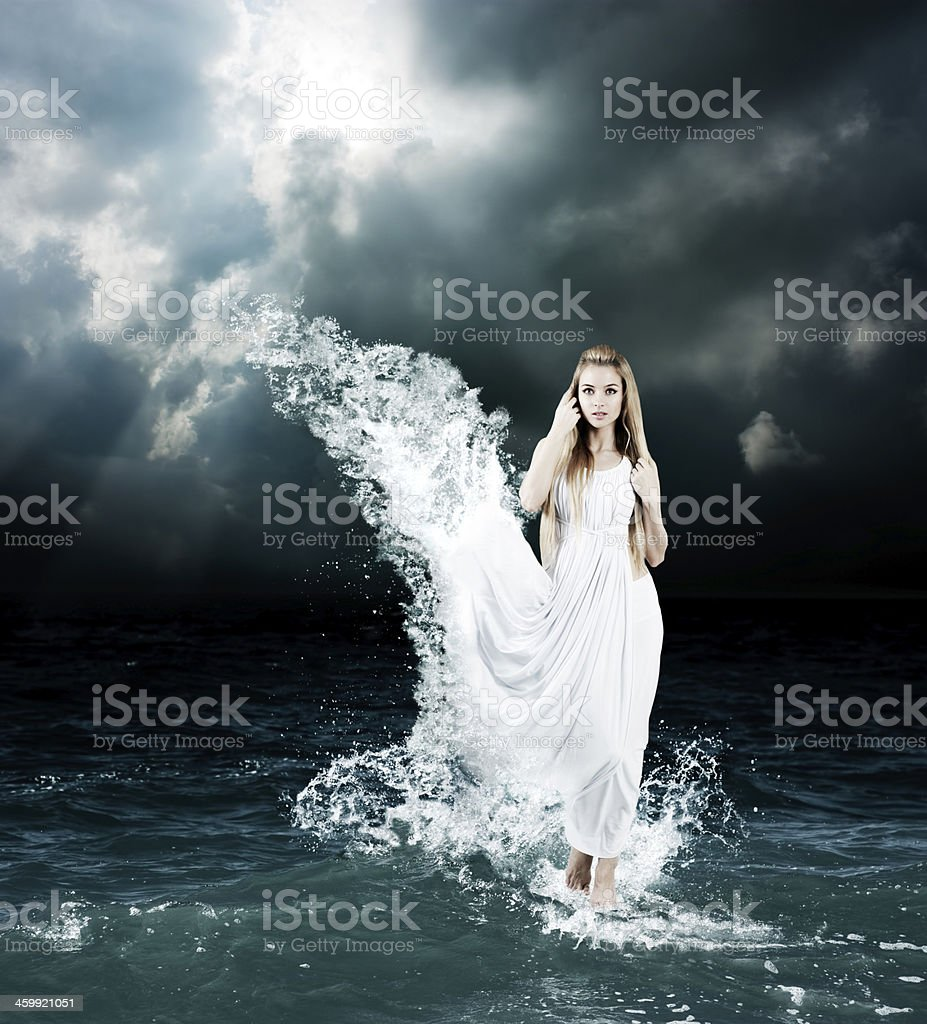 A mystic goddess appearing out of a stormy sea stock photo