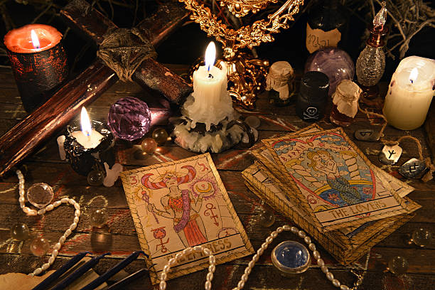 Mystic ritual with tarot cards, magic objects and candles stock photo