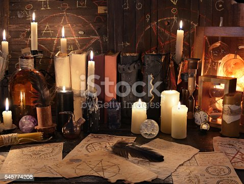 811119304 istock photo Mystic still life with magic objects, books and candles 545774208