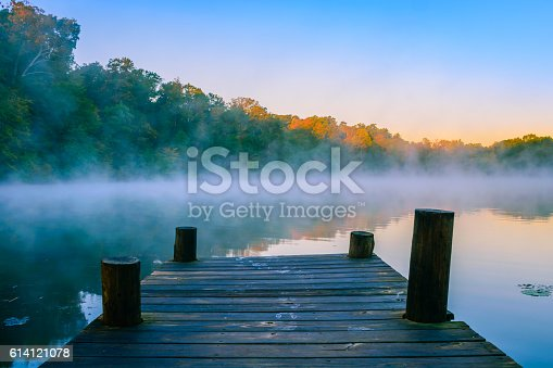 Morning mist on reflective water, Mt Saint Francis, Indiana.