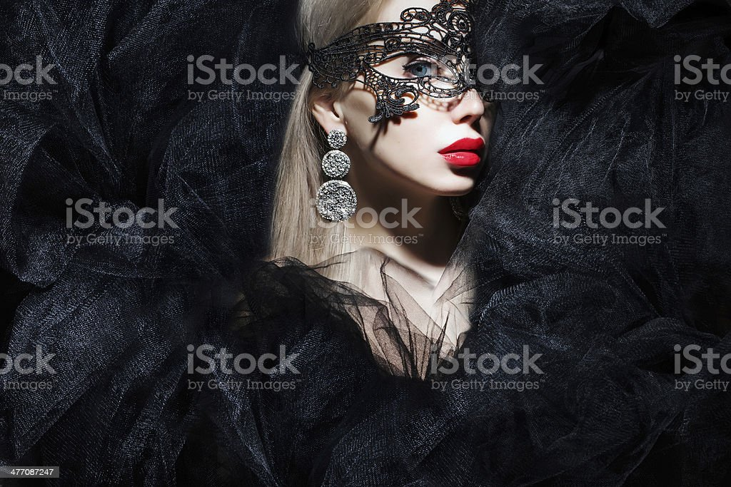 mystic woman in mask stock photo