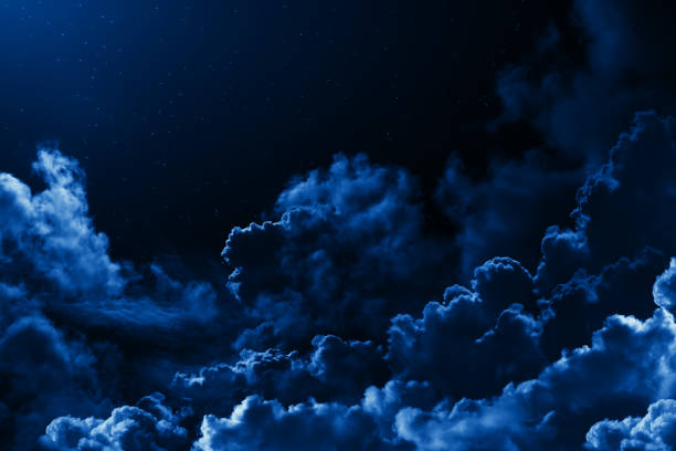 mystical midnight sky with stars surrounded by dramatic clouds. dark natural background with night starry cloudy sky. moonlit clouds - céu a noite imagens e fotografias de stock