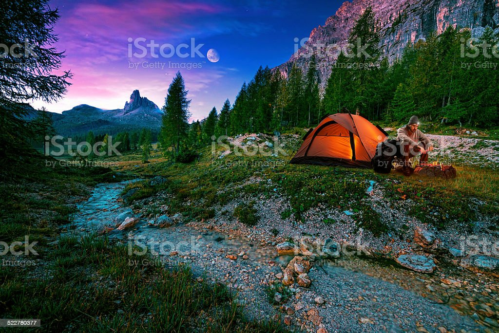 Mystical night landscape, in the foreground hike, campfire and tent stock photo