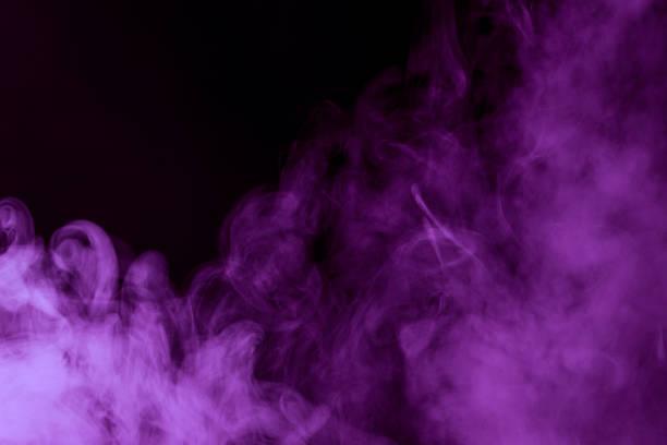 mystical purple steam on a dark background Cloud Close up stock photo