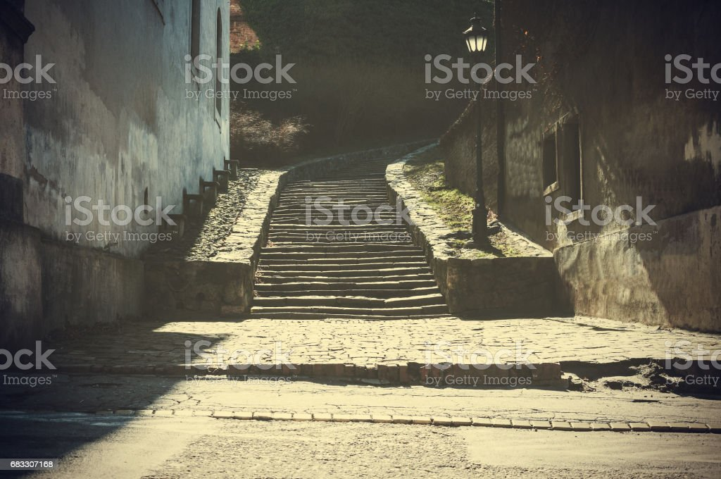 Mystical stairway. Stairway of old fortress. Foggy highlights and shadows. Dark image. Fairytale background. foto stock royalty-free