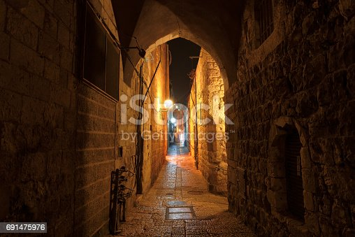 istock Mystical street at night in the old city of Jerusalem. 691475976