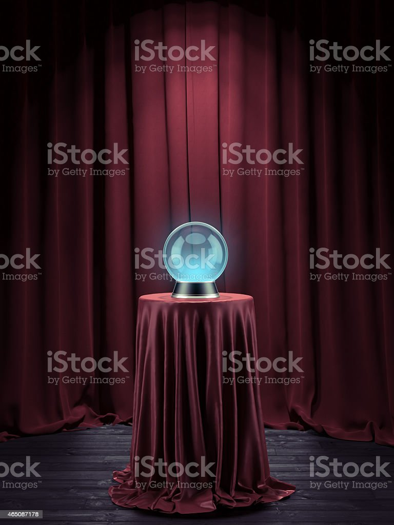 A Mystics glass globe on red velvet pedestal stock photo