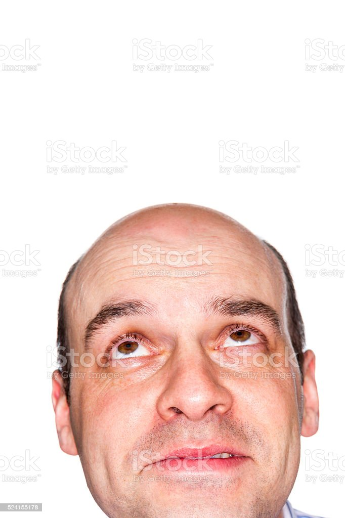 Mystified adult male with facial expression looking up stock photo