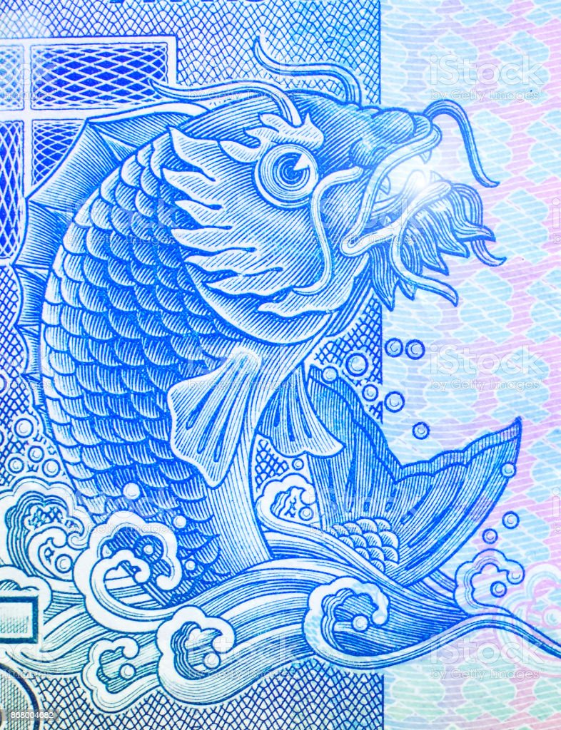 Mythical fish on the fragment of old ten Hong Kong Dollars banknote close-up stock photo