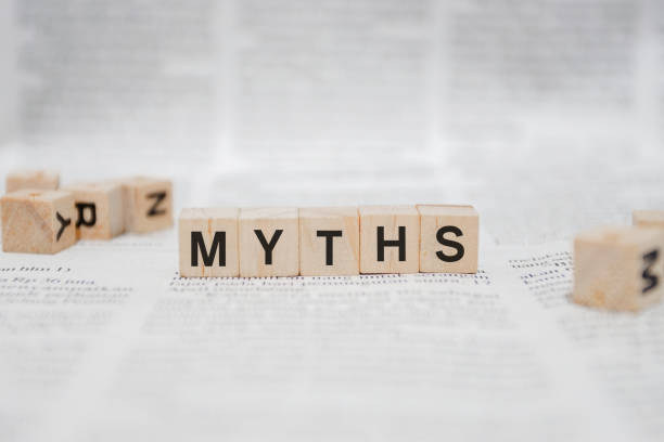 Myths Word Written In Wooden Cube - Newspaper stock photo
