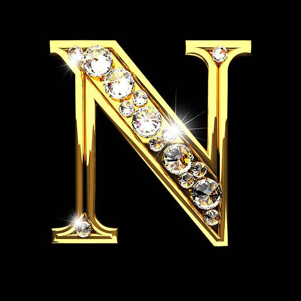 n isolierte goldene Buchstaben mit Diamanten auf Schwarz – Foto