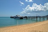 Ferry and pier in a tropical beach of Koh Samui, Thailand.