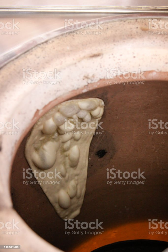 Naan bread inside oven stock photo